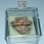 Granite natural mineral/gemstone specimen in display case